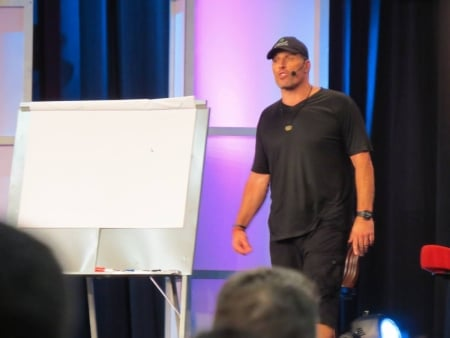 Tony Robbins is 6 '7, all muscle, very excited is this is one the few times he stopped moving so I could take a shot.