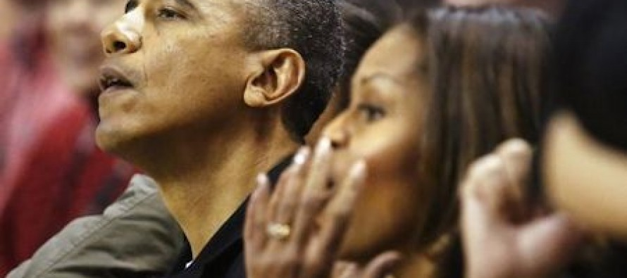 Obamas booed at college basketball game