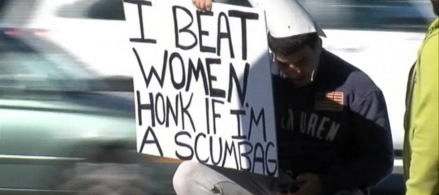 "Victim Orders Man to Sit on Street Corner with Sign Reading ""I Beat Women. Honk If I'm a Scumbag"" (Video)"