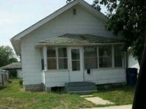 Here's a photo the police took of the house.  Oh, and it looks like something is standing in the front window.