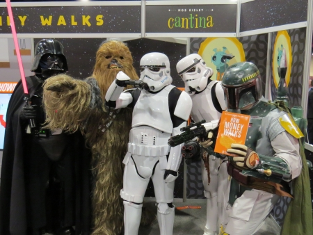 """Star Wars characters promoting """"Money Walks"""" in the exhibition hall."""