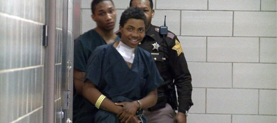 Smirking teen LAUGHS as he enters court after shooting newlywed father-to-be dead