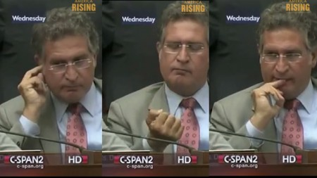 Florida Rep. Joe Garcia eating earwax