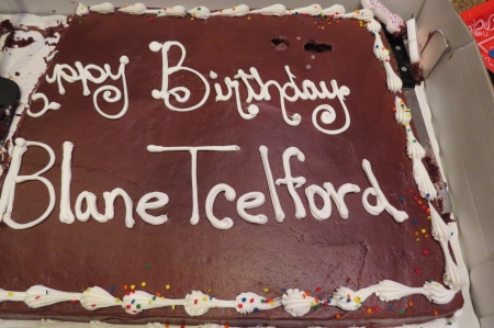 The worst birthday cake captioning ever. That's supposed to be Erik Telford's Twitter handle, blametelford.