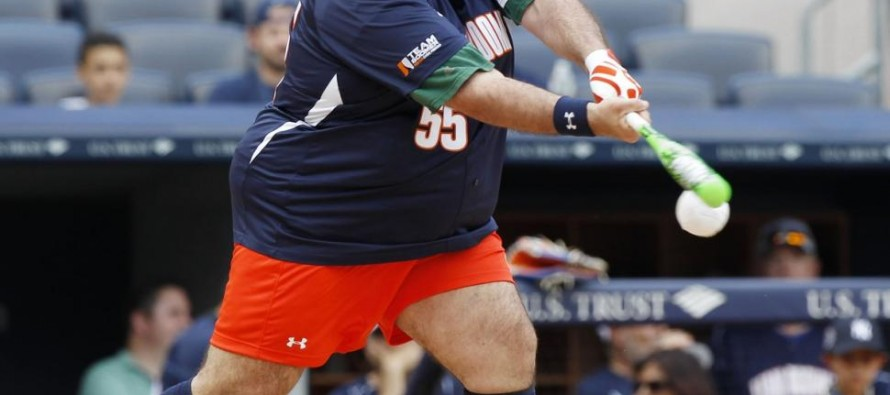 Gov. Chris 'El Hippo' Christie takes break from New Jersey politics to play in celebrity softball match at Yankee Stadium