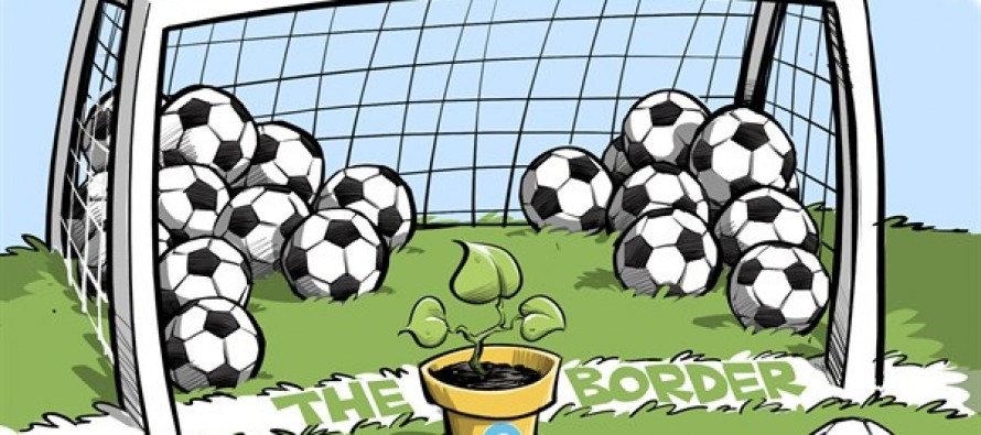 Obama the goal keeper (Cartoon)