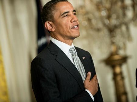 obama-halfhearted-pledge-afp (450x337)