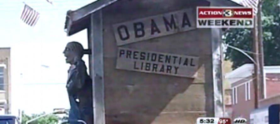 Justice Dept finally finds 'real' scandal; looking at Obama outhouse parade float