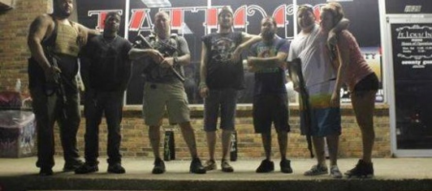 Armed Guards at Strip Mall Save North St. Louis Businesses From Looters