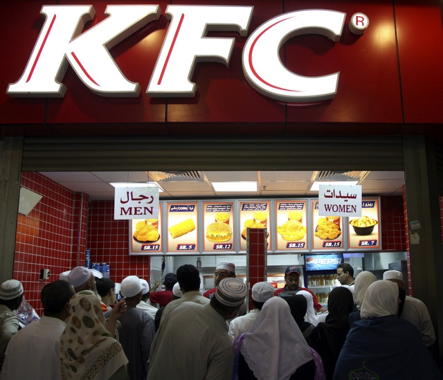 Muslim pilgrims line up at a KFC restaurant outside Grand Mosque in Mecca