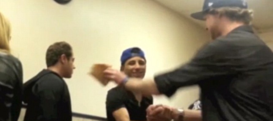FUNNY VIDEO: Prankster gets knocked unconscious when a guy he hit in the face with a pizza slice takes revenge