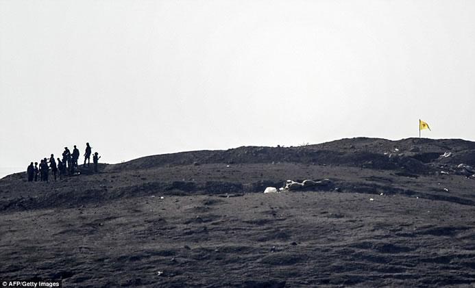 The Kurdish resistance movement raised its triangular flag immediately afterwards.