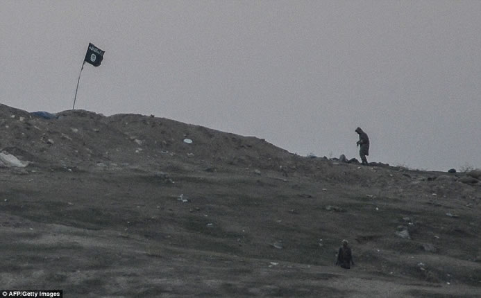 The ISIS flag right before it was blown to bits.