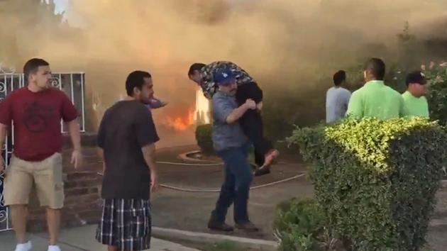 man saves from burning house