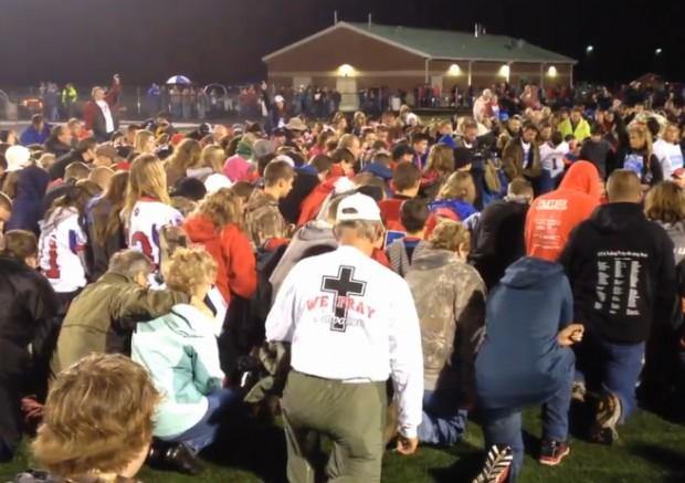 pray hundreds at football field