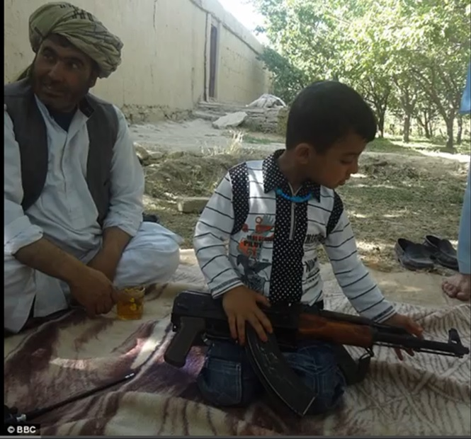 toddler taliban with gun