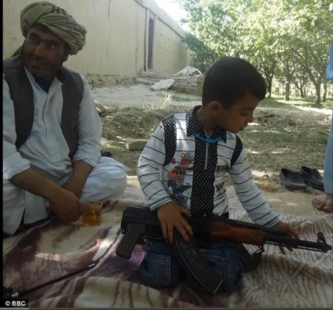 toddler taliban with gun