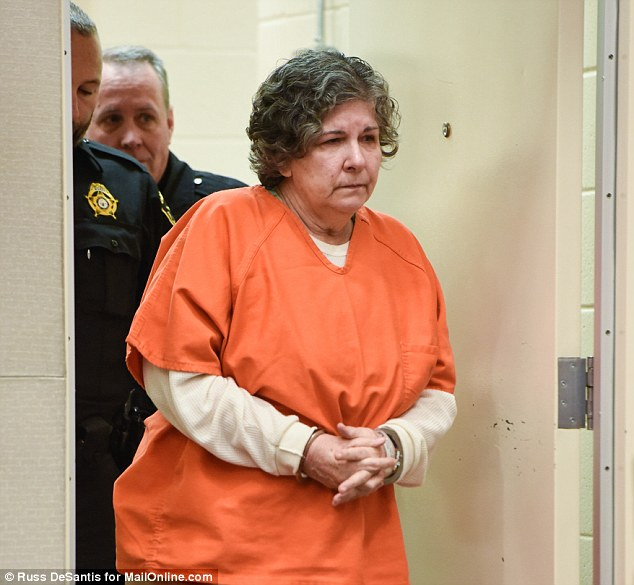 Loretta Doyle Burroughs being escorted into the court room. She is being held on $2M bail.