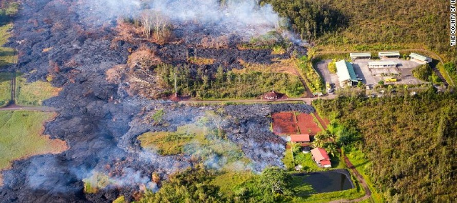 VIDEO: The Devastating Moment a Lava Flow That Has Been Slowly Inching Down a Hawaii Mountain for Four Months Engulfs Its First Home
