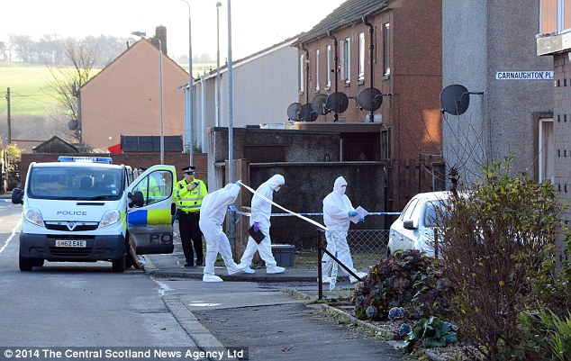 A forensics team enters the flat in Alva,  Clackmannanshire where five year old Scott Chiriseri was found dead