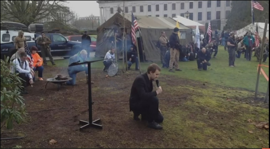 Organizer Gavin Seim invited all 1,000 plus attendees to kneel in prayer with him.