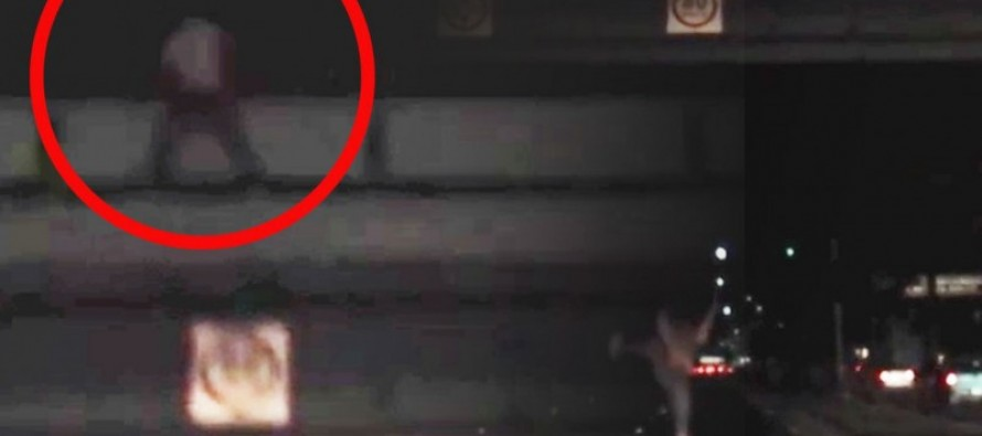 [VIDEO] Man High on Drugs Jumps Off a Bridge onto a Highway to Escape the Cops!