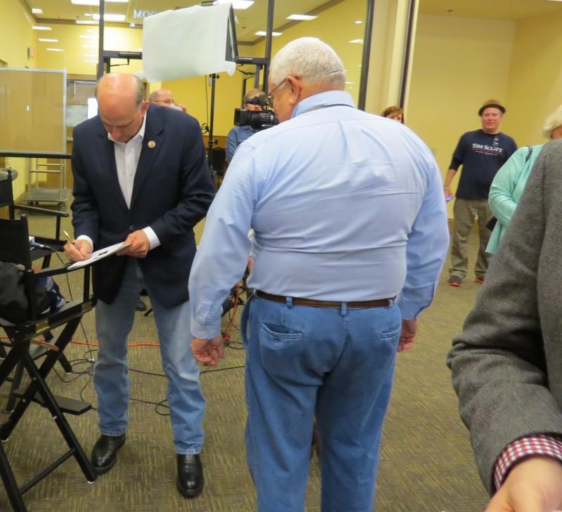 Louie Gohmert signing an autograph