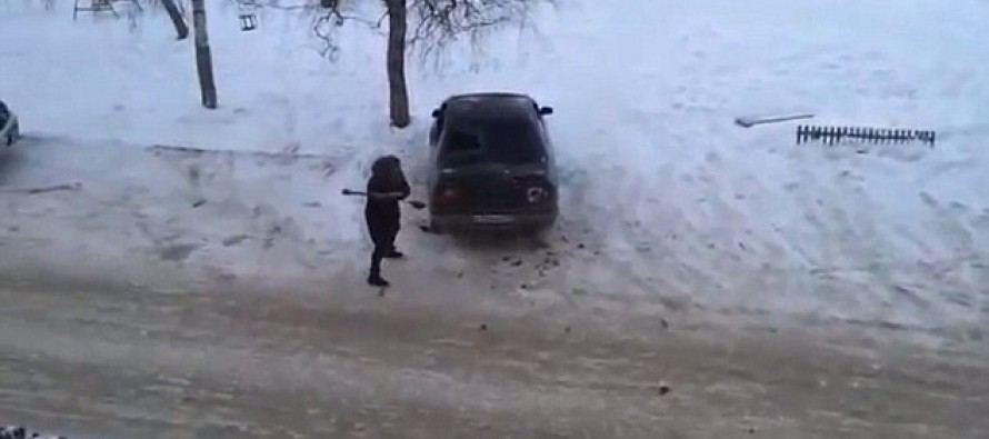 VIDEO! Russian woman braves the Siberian snow to destroy ex-husband's car with an AXE