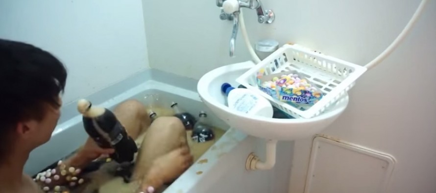 VIDEO: This is the video of a guy covering himself in mentos and jumping in a bath full of Coke Zero