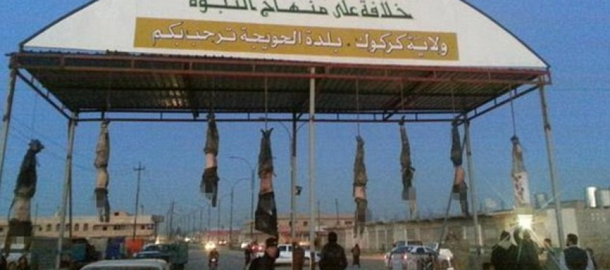 THE RELIGION OF PEACE??: ISIS Displays Hanging Bodies of 'Soldiers' from Entrance to the City
