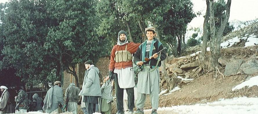 Photos of Osama bin Laden Show Him Grinning in His Tora Bora Hideout, Hiding Behind Children Wielding Kalashnikovs