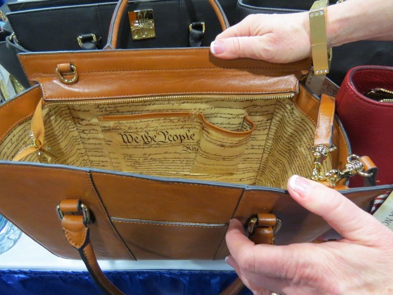 Sylvia Noster was selling conservative purses in the vendor area