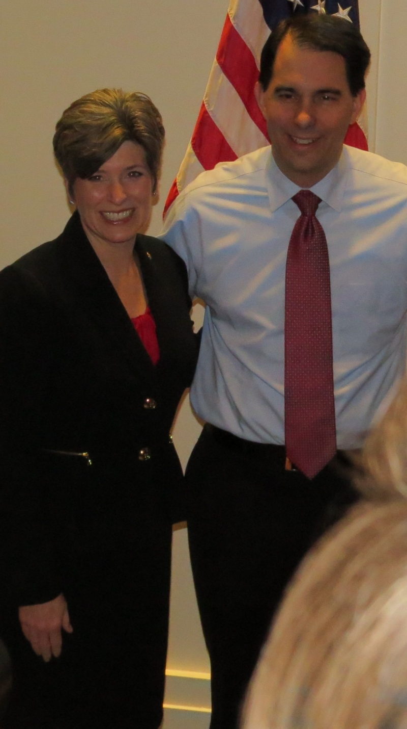 I talked my way into a private Scott Walker event that night and took this snap of Joni Ernst taking a picture with Scott Walker