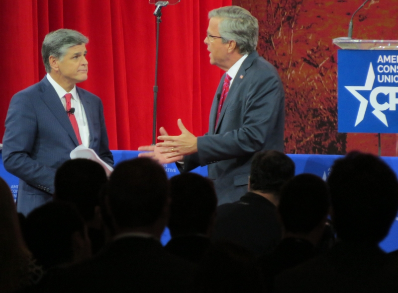 Jeb Bush talks with Sean Hannity at CPAC