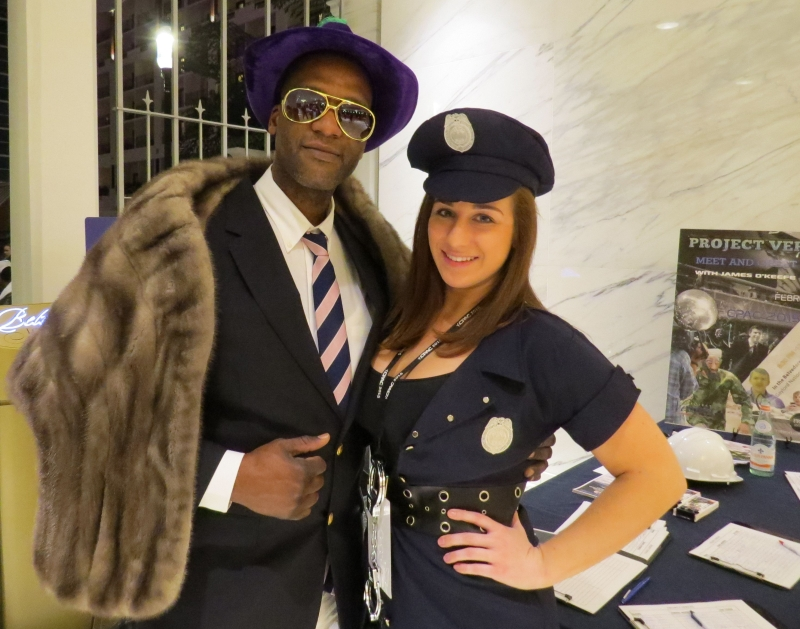 Workers dressed up as a pimp and cop from James O'Keefe's full to overflowing Project Veritas Party