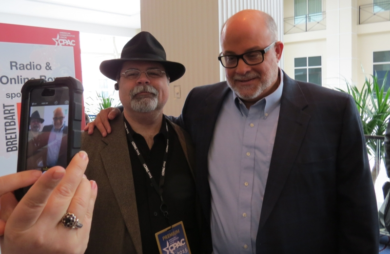 Mark Levin roaming the halls after his speech took a picture with Right Wing News's Warner Todd Huston