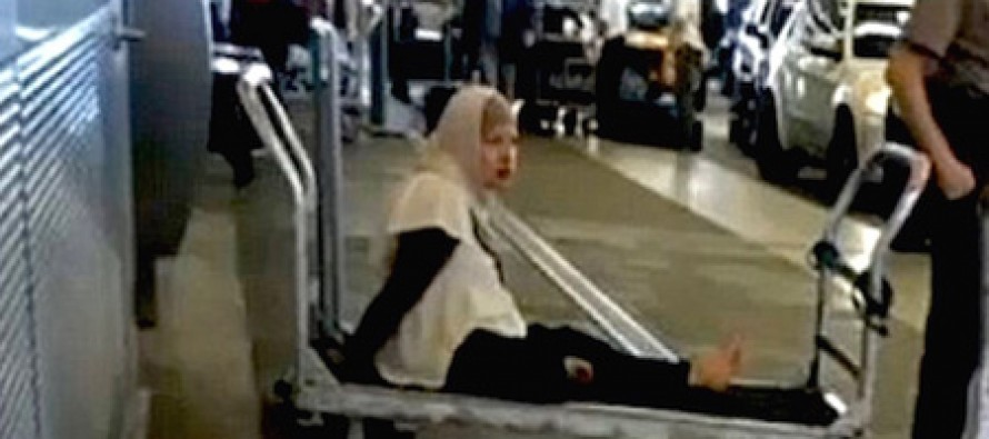 Muslim woman handcuffed to luggage cart after screaming she had a bomb