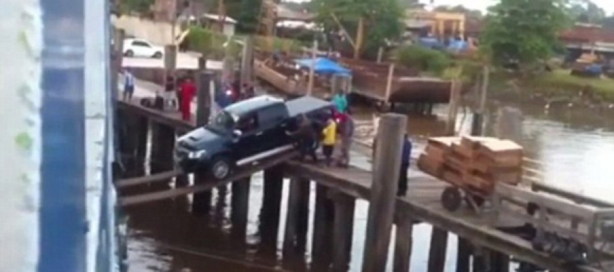 Will they make it? Cargo crew's nail-biting attempt to load a truck onto a ship has crowds gathering to see if it falls in…