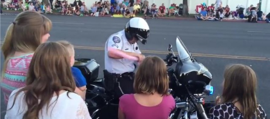 Cop stops in the middle of a parade to make balloon animal for boy with autism [Video]