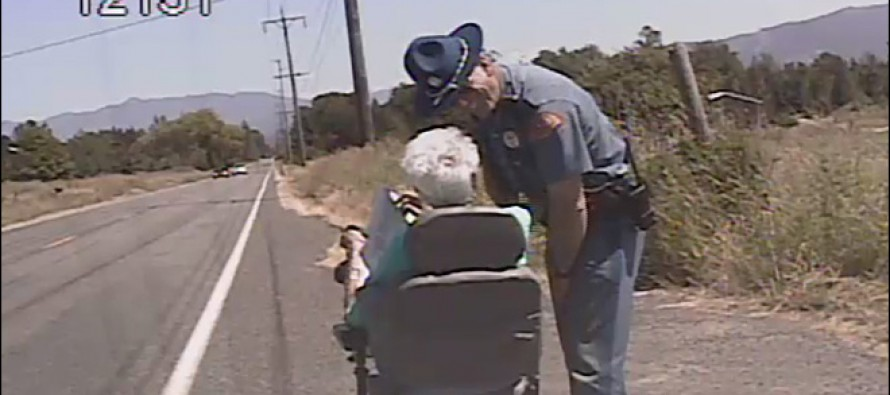 Cop escorts elderly woman on scooter going 3 mph: 'Just trying to get her home'