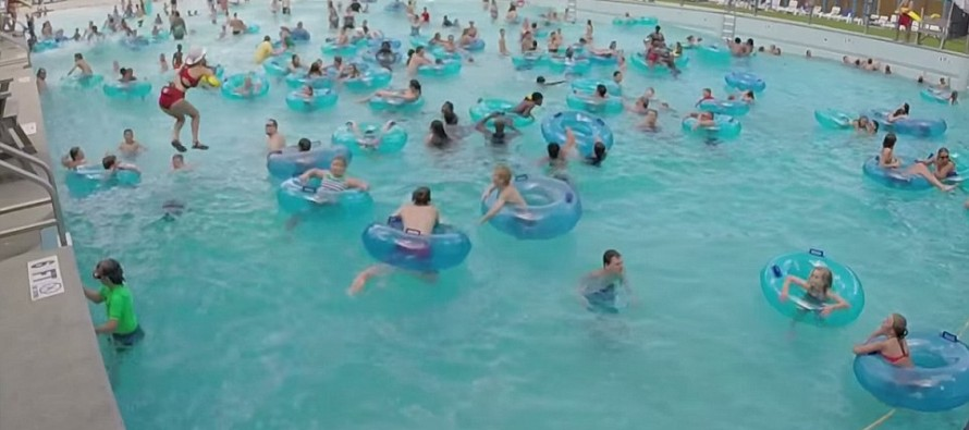 Can you spot the drowning swimmer? Incredible moment on-the-ball lifeguard rescues struggling child in wave machine pool full of people