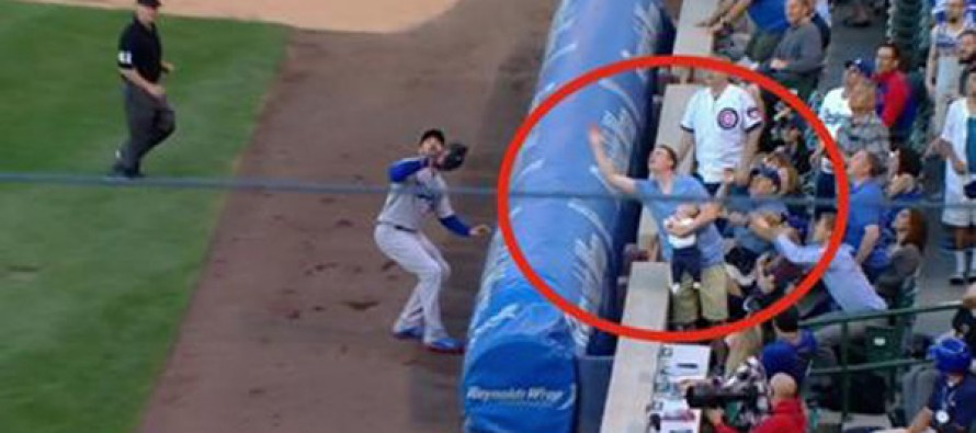 Man Holding Baby Makes Crazy Catch at Wrigley Field That Stuns Sportscasters