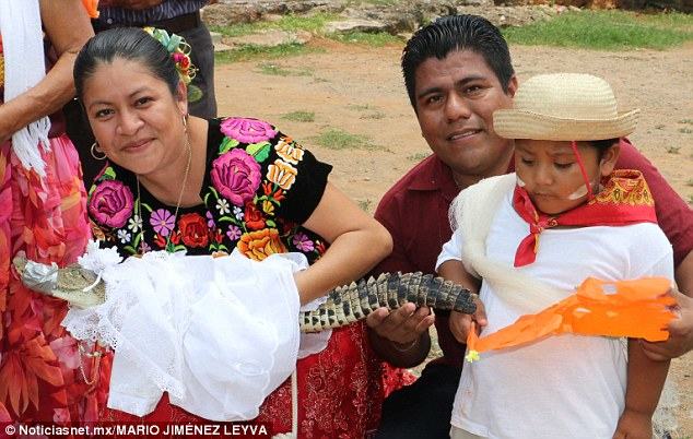 Joel Vazquez Rojas , the mayor of San Pedro Huamelula in Mexico, married an alligator believed to be a princess (above with his human wife, alligator bride, and human child).