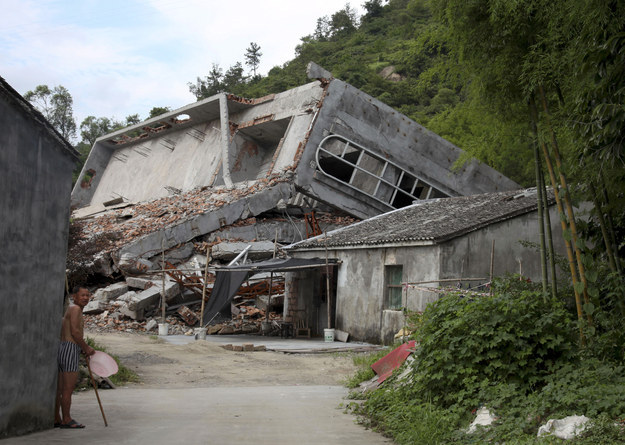 A man stands near the razed remains of a Catholic church in a village in Pingyang county of Wenzhou in eastern China's Zhejiang province. Didi Tang / AP