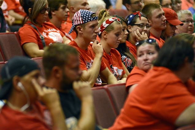Goshen High alumnus JT Plavchak listens during the Goshem Community Schools board meeting Monday, July 27, 2015 inside Goshen High School auditorium. The board voted 5-2 to retire the Redskins mascot. (Sarah Welliver/The Elkhart Truth)