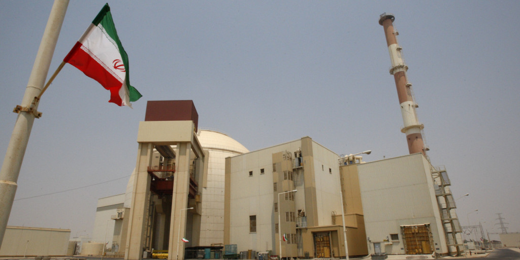 An Iranian flag flutters in front of the reactor building of the Bushehr nuclear power plant, just outside the southern city of Bushehr, Iran, Saturday, Aug. 21, 2010. Iranian and Russian engineers began loading fuel Saturday into Iran's first nuclear power plant, which Moscow has promised to safeguard to prevent material at the site from being used in any potential weapons production. (AP Photo/Vahid Salemi)