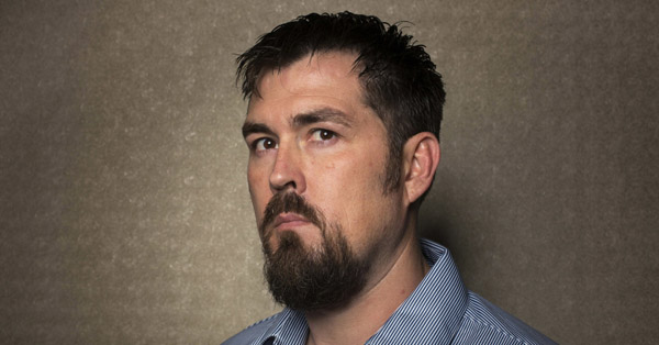 """Former U.S. Navy SEAL Marcus Luttrell poses for a portrait while promoting the film """"Lone Survivor"""" in New York, December 5, 2013."""