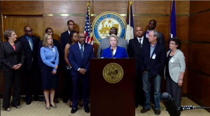 (Photo: Screen Grab via YouTube/MayorAnniseParker) Houston Mayor Annise Parker (at podium) announces the withdrawal of subpoenas for the sermons of five local pastors at a press conference on Wednesday October 30, 2014.