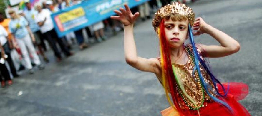 Child Abuse Leftists get away with:  8-Year-Old boy prances at Gay Pride in Obama's New World