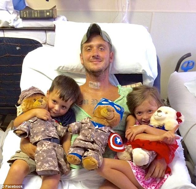 In this Facebook photo posted on Sunday, Tim is seen with his two children Hallie Kate and Connor in his hospital bed.